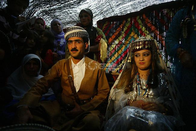 ERBIL, IRAQ: The bride and groom at a Kurdish wedding ceremony...Images from a traditional Kurdish wedding in Iraqi Kurdistan...Photo by Safin Hamid