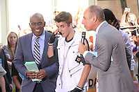 Justin Bieber with hosts Al Roker and Matt Lauer on NBC's Today Show Toyota Concert Series in New York City. June 15, 2012. © RW/MediaPunch Inc.