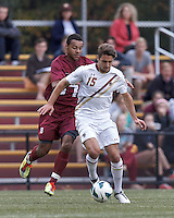 Harvard University midfielder Andrew Wheeler-Omiunu (18) and Boston College midfielder Giuliano Frano (15) battle for the ball. Boston College (white) defeated Harvard University (crimson), 3-2, at Newton Campus Field, on October 22, 2013.