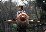 In the future, this youngster might pilot a real MIG instead of flying in an amusement ride in Lenin Park in Hanoi, North Vietnam.  (Jim Bryant Photo).....