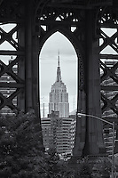 The Empire State Building framed by the supports of the Manhattan Bridge in Brooklyn.