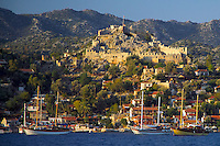 Antalya, Turkey, October 2005. Simena also known as kalekoy, features a fortress on the hill. Sailing the Turkish coast in a wooden Gulet takes one along the most beautiful stretches of the Mediterranean. Small fishing villages, ancient Lycian and Byzantine ruins are scattered in the mountainous landscape lined by tranquil beaches and small islands. Photo by Frits Meyst / MeystPhoto.com