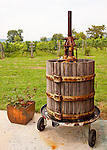An old wine press stands at the corner of the patio outside Philip Carter Winery.
