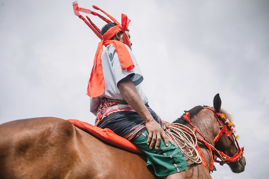 A Pasola warrior during the event in Waiha, Kodi. Pasola is an ancient tradition from the Indonesian island of Sumba. Categorized as both extreme traditional sport and ritual, Pasola is an annual mock horse warfare performed in response to the harvesting season. In the battelfield, the Pasola warriors use blunt spears as their weapon. However, fatal accident still do occurs.