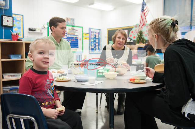 Four-year-old CCS Early Learning client Charles Armstrong takes a break from his luncheon discussions with FNBA Eagle River branch manager Marty Crow, board member Pat Purcell and his volunteer mom Samantha Thursday, Dec. 8, 2016.  Photo for the Star by Michael Dinneen