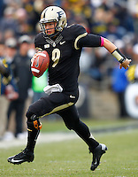 WEST LAFAYETTE, IN - OCTOBER 06: Quarterback Robert Marve #9 of the Purdue Boilermakers scrambles out of the pocket against the Michigan Wolverines at Ross-Ade Stadium on October 6, 2012 in West Lafayette, Indiana. (Photo by Michael Hickey/Getty Images) *** Local Caption *** Robert Marve