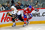 20 December 2008: Buffalo Sabres' defenseman Chris Butler avoids a check by Montreal Canadiens' right wing forward Guillaume Latendresse during the third period at the Bell Centre in Montreal, Quebec, Canada. With both teams coming off wins, the Canadiens extended their winning streak by defeating the Sabres 4-3 in overtime. ***** Editorial Sales Only ***** Mandatory Photo Credit: Ed Wolfstein Photo