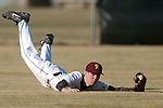 ORIG./Ryan Brennecke/The Bulletin/ 03-19-10..Redmond's Cody Bulkley (1) dives to catch a shallow fly ball hit to right field during the sixth inning against Mountain View Friday..