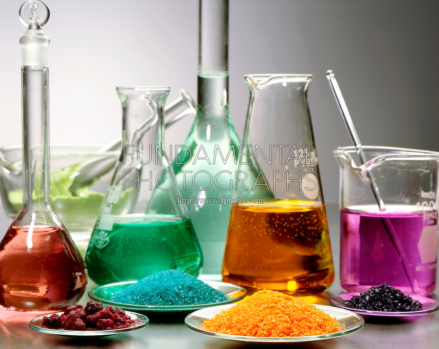 LABGLASS CONTAINING TRANSITION METAL COMPOUNDS<br /> Solids &amp; Solutions in Mortar, Flasks &amp; Watchglass<br /> Pale green Nickel Chloride in mortar &amp; flask; blue-green Nickel Sulfate in flask &amp; watchglass; crimson Cobalt Chloride in watchglass &amp; flask; orange Sodium Dichromate in watchglass &amp; flask; purple Potassium Permanganate in beaker &amp; watchglass.