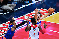 Wizards John Wall has a tough time with the Knicks defense. New York defeated Washington 115-104 during a NBA preseason game at the Verizon Center in Washington, D.C. on Friday, October 9, 2015.  Alan P. Santos/DC Sports Box