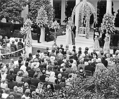 Washington, DC - June 12, 1971 -- Mr. and Mrs. Edward Cox leave the Rose Garden of the White House in Washington, D.C. after exchanging marriage vows on Saturday, June 12, 1971 at the White House ceremony..Credit: Bernie Boston - Pool via CNP