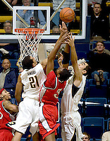 11 November 2009:  Lamar Lee of Detroit fights for a loose ball against California defenders' Omondi Amoke and Max Zhang during the game at Haas Pavilion in Berkeley, California.   California defeated Detroit, 95-61.