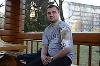 Boris, 26, of Simferopol, Crimea sits in the garden of the Feofaniya Hospital on the outskirts of Kiev, Ukraine on April 2, 2014.  Boris was injured in the left shoulder by a sniper's bullet that left an exit wound on Institutskaya Street under a pedestrian bridge on February 20, 2014 and has been hospitalized ever since.  <br /> <br /> &quot;It started for me when the students were beaten, that was the last straw.  That is why all the authorities in power should be changed.  Of course it is the previous authorities who are responsible, they were given orders.  For now, I want to see the economy grow and I want Crimea back [in Ukraine].  For now, I'm going to stay in Kiev until the occupiers leave Crimea.  I couldn't go back there now, it is very dangerous for me.&quot;