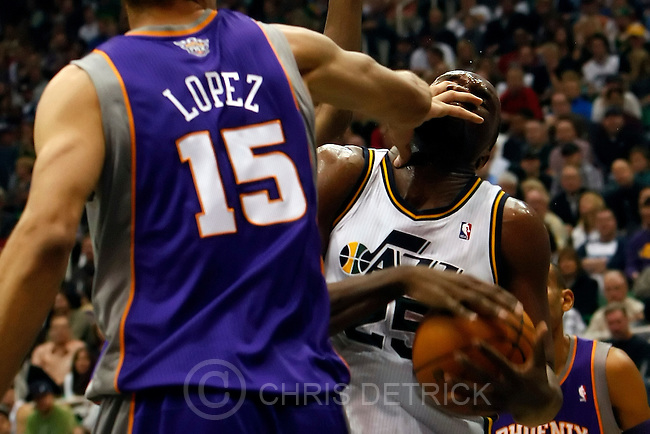 Chris Detrick  |  The Salt Lake Tribune .Phoenix Suns center Robin Lopez #15 guards Utah Jazz center Al Jefferson #25 during the first half of the game Thursday October 28, 2010.  Phoenix is winning the game 58-42.
