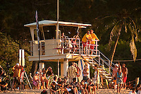 HALEIWA, HI Dec. 1, 2005 The opening ceremony of the Quiksilver in Memory of Eddie Aikau was held today at Waimea Bay. This year's event  will be held on one day , between December 1, 2005 and February 28, 2006, when the waves eceed the  20 foot  minimum threshold and the 28 invitees will compete for the $98.000 prize purse...The northern hemisphere winter months on the North Shore signal a concentration of surfing activity with some of the best surfers in the world taking advantage of swells originating in the stormy Northern Pacific. Notable North Shore spots include Waimea Bay, Off The Wall, Backdoor, Log Cabins, Rockpiles and Sunset Beach... Ehukai Beach is more  commonly known as Pipeline and is the most notable surfing spot on the North Shore. It is considered a prime spot for competitions due to its close proximity to the beach, giving spectators, judges, and photographers a great view...The North Shore is considered to be one the surfing world's must see locations and every December hosts three competitions, which make up the Triple Crown of Surfing. The three men's competitions are the Reef Hawaiian Pro at Haleiwa, the O'Neill World Cup of Surfing at Sunset Beach, and the Billabong Pipeline Masters. The three women's competitions are the Reef Hawaiian Pro at Haleiwa, the Gidget Pro at Sunset Beach, and the Billabong Pro on the neighboring island of Maui...Photo: Joliphotos.com
