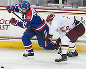 Joseph Pendenza (UML - 14), Bill Arnold (BC - 24) - The Boston College Eagles defeated the visiting University of Massachusetts Lowell River Hawks 3-0 on Friday, February 21, 2014, at Kelley Rink in Conte Forum in Chestnut Hill, Massachusetts.