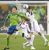 Todd Dunivant wins the battle for the ball with a header against Alvaro Fernandez during play at Qwest Field in Seattle Tuesday March 15, 2011. The Galaxy won the game 1-0.