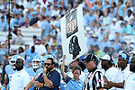 17 September 2016: A member of the UNC team staff holds up a play calling card. The University of North Carolina Tar Heels hosted the James Madison University Dukes at Kenan Memorial Stadium in Chapel Hill, North Carolina in a 2016 NCAA Division I College Football game.