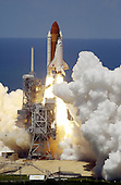 Kennedy Space Center, FL - July 4, 2006 -- Space Shuttle Discovery kicks off the Fourth of July fireworks with its own fiery display as it rockets into the blue sky, spewing foam and smoke over the ground, on mission STS-121. It was the third launch attempt in four days; the others were scrubbed due to weather concerns. Liftoff was on-time at 2:38 p.m. EDT. During the 12-day mission, the STS-121 crew of seven will test new equipment and procedures to improve shuttle safety, as well as deliver supplies and make repairs to the International Space Station. Landing is scheduled for July 17 at Kennedy's Shuttle Landing Facility. .Credit: Nikon/Scott Andrews - NASA via CNP