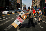 A worker carries box with food at downtown Manhattan in New York. United States economy has gained 114,000 jobs, putting the jobless rate from 8.1 percent to 7.8 percent, first time it's been below 8 percent since 2009.  Photo by Eduardo Munoz Alvarez / VIEW.