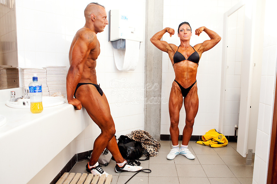 23/10/2010. Irish female physique and figure fitness national championships.  Sophia Mc Namara (1st place winner) and her boyfriend David Cassidy (winner of the Classic bodybuilding category) from Limerick are pictured pumping up backstage in the women's toilets during the female physique category as part of the 2010 RIBBF national bodybuilding championships at the University of Limerick Concert Hall, Limerick, Ireland. Picture James Horan.