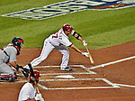 12 October 2012: Washington Nationals pitcher Gio Gonzalez attempts a bunt during Postseason Playoff Game 5 of the National League Divisional Series against the St. Louis Cardinals at Nationals Park in Washington, DC. The Cardinals stunned the home team with a four-run rally in the 9th inning to defeat the Nationals 9-7 and win the NLDS, moving on to the NL Championship Series. Mandatory Credit: Ed Wolfstein Photo