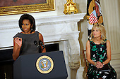 First lady Michelle Obama delivers remarks, with Dr. Jill Biden, to the National Governors Association during a meeting in the White House State Dining Room, on Monday, February 27, 2012, in Washington, DC. .Credit: Leslie E. Kossoff / Pool via CNP