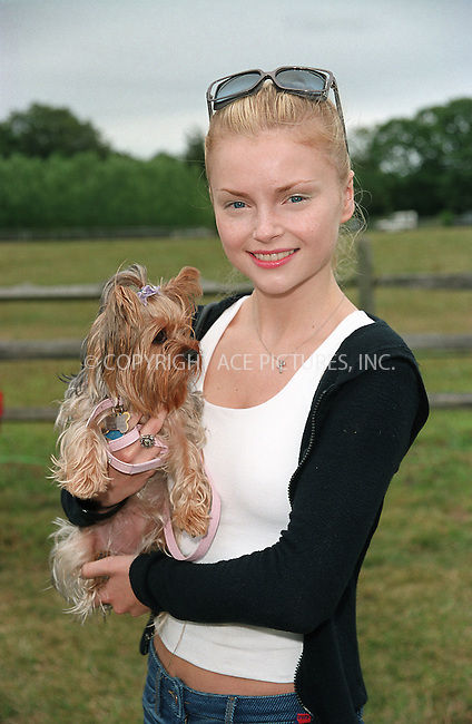 """Izabella Miko with her dog Layla (Laila) at the Fifth Annual """"Super Saturday"""" designer sale and family event to benefit the ovarian cancer research fund. Water Mill, Long Island. July 27, 2002. Please byline: Alecsey Boldeskul/NY Photo Press.   ..*PAY-PER-USE*      ....NY Photo Press:  ..phone (646) 267-6913;   ..e-mail: info@nyphotopress.com"""