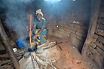 A woman cooks her family's meal in Dundube Kadambo, in northern Malawi.