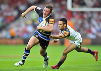 Richard Lane goes on the attack. J.P. Morgan Premiership Rugby 7s match, between Bath Rugby and Worcester Warriors on July 27, 2012 at Kingsholm Stadium in Gloucester, England. Photo by: Patrick Khachfe / Onside Images
