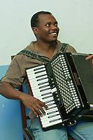 Zanzibar, Tanzania.  Taarab Musicians.  Culture Musical Club.  Accordion Player.