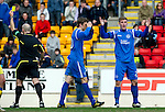 St Johnstone v Kilmarnock....02.04.11 .Jordan Robertson and Murray Davidson can't believe that ref Stephen Finnie didn't award a penalty for hand ball but instead booked Robertson for protesting too much..Picture by Graeme Hart..Copyright Perthshire Picture Agency.Tel: 01738 623350  Mobile: 07990 594431