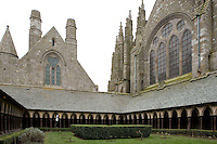 40 metres above the rock, the Cloister with its double row of frail looking arches on the garden side communicates with the Abbey Church, the Refectory and the Dormitory, the Merveille (Marvel), 13th century, thanks to a donation by the king of France, Philip Augustus who offered Abbot Jourdain, a grant for the construction of a new Gothic-style architectural set, Le Mont Saint Michel, Manche, Basse Normandie, France. Picture by Manuel Cohen
