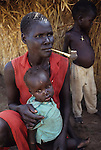 A  Dinka mother & child displaced  by the war in South Sudan.  Atepi ,  triple A camp