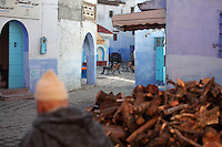 Streets of the medina or old town with a pile of wood for the hammam, Chefchaouen, in the Rif mountains of North West Morocco. Chefchaouen was founded in 1471 by Moulay Ali Ben Moussa Ben Rashid El Alami to house the muslims expelled from Andalusia. It is famous for its blue painted houses, originated by the Jewish community, and is listed by UNESCO under the Intangible Cultural Heritage of Humanity. Picture by Manuel Cohen