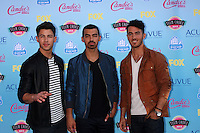 LOS ANGELES - AUG 11:  Nick Jonas, Joe Jonas, Kevin Jonas at the 2013 Teen Choice Awards at the Gibson Ampitheater Universal on August 11, 2013 in Los Angeles, CA
