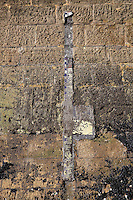 Measuring stick to record the level of the tide, on the wall of the Phare de Cordouan, or Cordouan Lighthouse, built 1584-1611 in Renaissance style by Louis de Foix, 1530-1604, French architect, located 7km at sea, near the mouth of the Gironde estuary, Aquitaine, France. This is the oldest lighthouse in France. There are 4 storeys, with keeper apartments and an entrance hall, King's apartments, chapel, secondary lantern and the lantern at the top at 68m. Parabolic lamps and lenses were added in the 18th and 19th centuries. The lighthouse is listed as a historic monument. Picture by Manuel Cohen