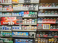 A cwall of cigarettes in convenience store in New York on Saturday, June 29, 2013. The New York City Council is putting forward a bill that would raise the minimum age to purchase tobacco from 18 to 21 years old. (© Richard B. Levine)
