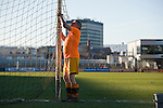 Newport County 1 Exeter City 1, 16/03/2014. Rodney Parade, League Two. Newport County finally return to the Football league after years of turmoil but a poor run of results has dented hopes of reaching the play-offs while Exeter City battle relegation. Groundsman taking down the nets after the game. Photo by Simon Gill