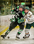 24 October 2015: University of North Dakota Defenseman Keaton Thompson, a Junior from Devils Lake, ND, is checked by University of Vermont Catamount Forward Brendan Bradley, a Junior from Warminster, PA in the second period at Gutterson Fieldhouse in Burlington, Vermont. North Dakota defeated the Catamounts 5-2 in the second game of their weekend series. Mandatory Credit: Ed Wolfstein Photo *** RAW (NEF) Image File Available ***