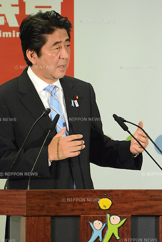 July 22, 2013, Tokyo, Japan - Japan's Prime Minister Shinzo Abe makes his point during a news conference at the Liberal Democratic Party headquarters in Tokyo on Monday, July 22, 2013, one day after a sweeping victory in an upper house election.<br /> <br /> The landslide victory in Sunday's election delivered 76 of the 121 contested Diet seats to the ruling LDP and its coalition partner, New Komeito, which now control both chambers. The result would give a boost to Abe and his efforts to get the nation's economy out of a 20-year-long slump. (Photo by Kaku Kurita/AFLO)