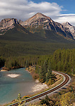 An empty train track is seen on a bright sunny day at Morant's Curve in Alberta Canada.