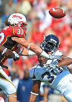 Panther's Jonathan Faucher loses his helmet after a violent tackle by the Terrapin's defense. Maryland defeated FIU 42-28 during a game at the Capital One Field at Byrd Stadium in College Park, MD on Saturday, September 25, 2010. Alan P. Santos/DC Sports Box