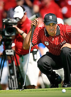 A camera follows Tiger Woods as he lines up a shot during the 2009 Tavistock Cup at Lake Nona Country Club in Orlando Florida, Monday, March 16, 2009. The golf tournament matches Isleworth Country Club golfers against Lake Nona golfers. (Roberto Gonzalez/Orlando Sentinel/MCT) ORG XMIT: 1070803