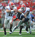 Georgia quarterback Aaron Murray (11) is tackled by Ole Miss' Vincent Moss (23) as Georgia guard Kenarious Gates (72) blocks at Vaught-Hemingway Stadium in Oxford, Miss. on Saturday, September 24, 2011. Georgia won 27-13.