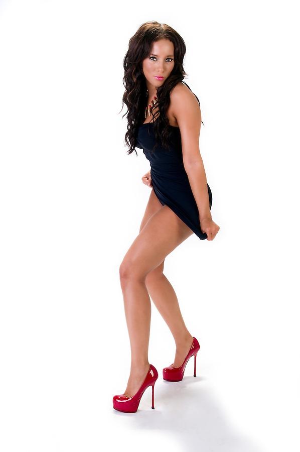 Sensual brunette standing with short skirt isolated white