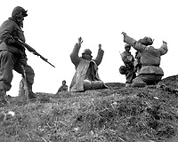 Men of the 1st Marine Division capture Chinese Communists during fighting on the central Korean front.  Hoengsong, March 2, 1951. Pfc. C. T. Wehner. (Marine Corps)<br /> NARA FILE #:  127-N-A6759<br /> WAR &amp; CONFLICT BOOK #:  1493
