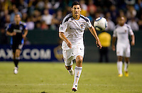 LA Galaxy defender Omar Gonzalez (4) chases down a loose ball. The LA Galaxy and the San Jose Earthquakes played to a 2-2 draw at Home Depot Center stadium in Carson, California on Thursday July 22, 2010.