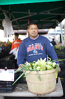 NEW YORK, NY - SEPTEMBER 19, 2013: Sergio Nolasco, a Mexican immigrant, farms many of his native herbs and vegetables in New York State and sells them at markets like this one in Washington Heights. CREDIT: Clay Williams for Edible Manhattan.<br /> <br /> <br /> &copy; Clay Williams / http://claywilliamsphoto.com