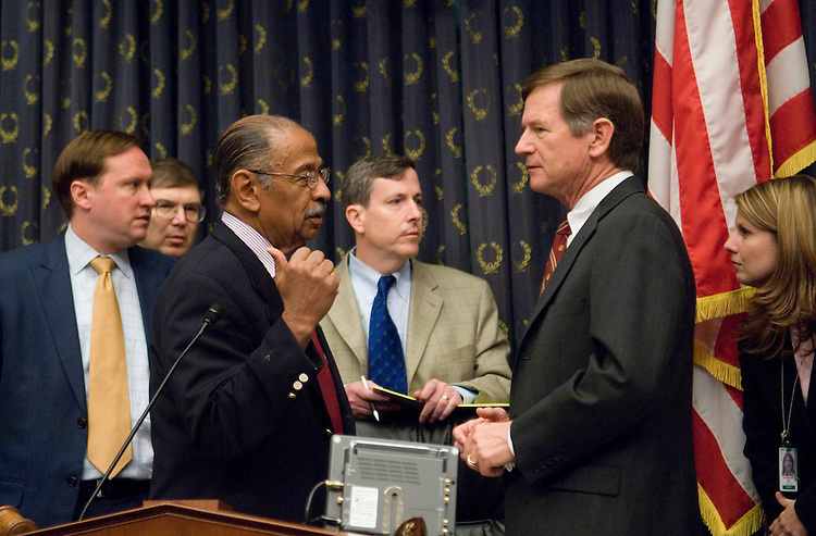 Chairman John Conyers, D-Mich., speaks with Rep. Lamar Smith, R-Texas, as the House Judiciary Committee considers issuing contempt of Congress Citations to former White House Counsel Harriet Miers and White House Chief of Staff Joshua Bolton, on Wednesday, July 25, 2007, following their refusal to comply with subpoenas issued in the U.S. Attorney investigation.
